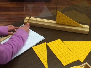student measuring yellow triangles